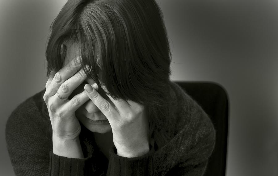 bigstock-Woman-in-depression-27254636